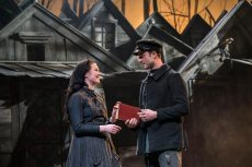 Fiddler-on-the-Roof-West-End-Musical-Couple-talking-both-holding-a-book